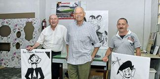 De izquierda a derecha: Arsenio González, Eladio Sánchez y Armando Felgueroso entre caricaturas de Marola