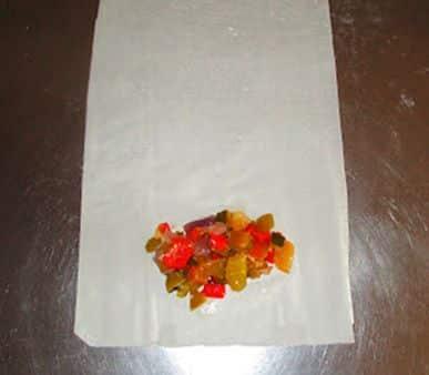 Elaboración de rollitos de pimientos y calabacín